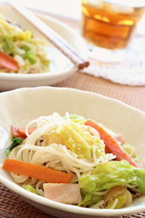 Stir fried rice noodle with vegetable and bacon  Stock Photo