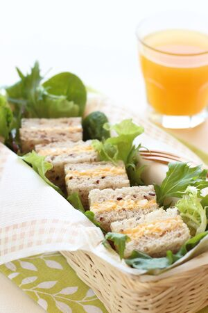 multi grain sandwich: Boiled egg sandwich on multigrain bread with green leaf salad and orange juice