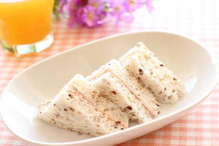 multi grain sandwich: Ham sandwich on multigrain bread  with orange juice  Stock Photo