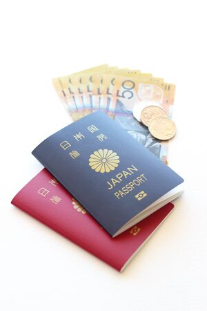 Japanese passports and Australian currency Stock Photo