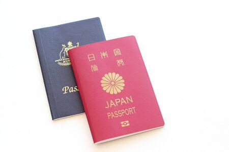 Two passports on white background