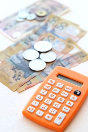 Australian dollar, Japanese Yen and calculator