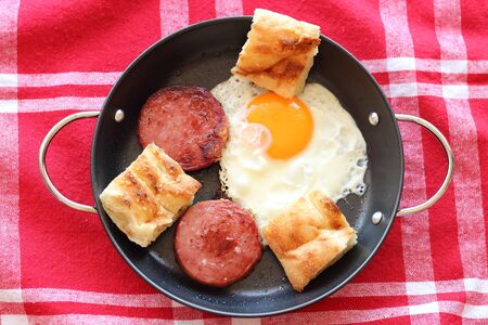 Gourmet breakfast sunny- side up egg and ham with turkish bread on pan Stock Photo