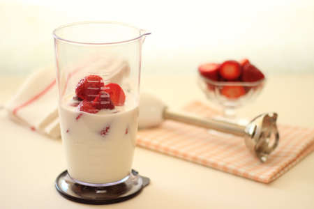 Strawberry and milk in multi blender Stock Photo