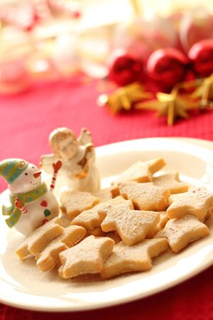 Christmas cookies and ornaments on red background