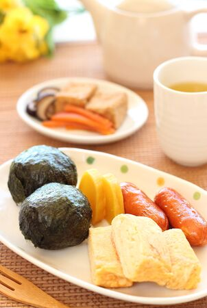 Japanese cuisine, Onigiri rice balls, egg roll and others photo