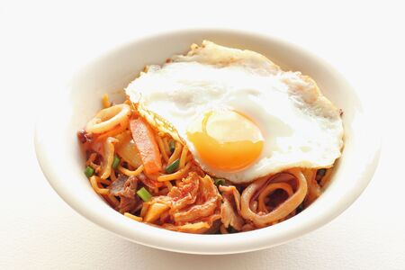 Japanese homemade cooking Vegetables and calamari spicy stir-fried noodle with fried egg