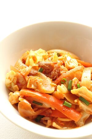 Spicy stir-fried noodle with vegetables and pork