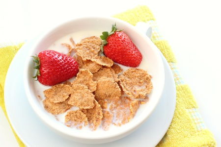 Granola cereal with strawberry in bowl