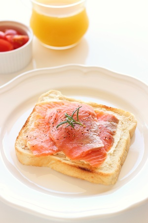 open topped: smoked salmon open sandwich on white plate  Stock Photo