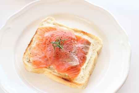 smoked salmon open sandwich on white plate  Stock Photo
