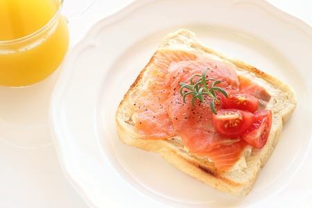 smoked salmon open sandwich on white plate  Stockfoto