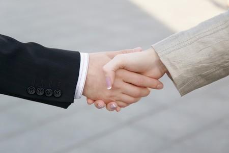 Handshake of businessman and businesswoman photo