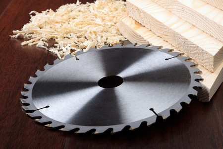 circ saw: Circ saw blades, planks and shavings on dark background