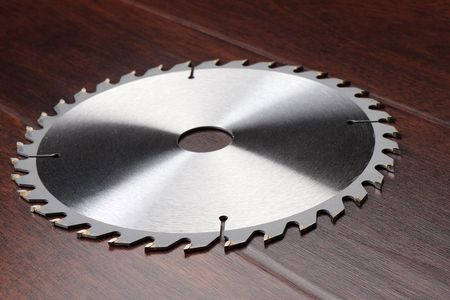 Circ saw blade on dark background photo