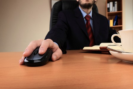 Businessman at office working at his workplace. Stock Photo - 8191728