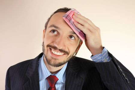 The businessman wipes a forehead by kerchief photo