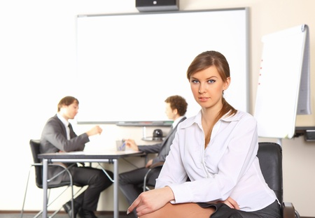 Portrait of business woman with team mates discussing in the background Stock Photo - 8496132
