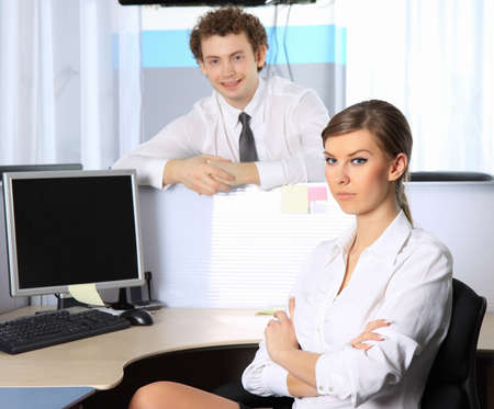 Business woman and her colleague working at office Stock Photo - 8496141