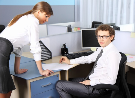 Business woman and her colleague working at office photo