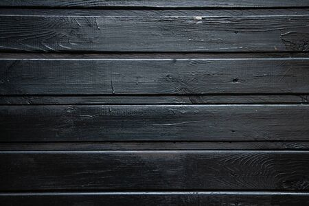 background of parallel wooden boards, black color, copy space Imagens