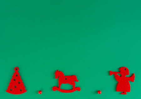 childrens Christmas, New Year card - red felt toys and gifts on a green background. Flat lay, copy space, top view