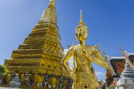 sard: Mythical female bird with a human head gold and Carrying a giant pagoda in wat pra sri rath tha na sard sa da ram in bangkok , thailand