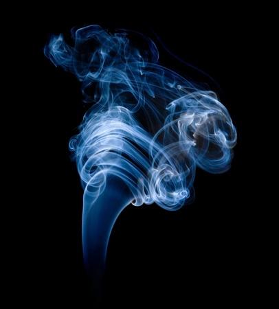 wisp of smoke on black;  photo