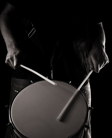 playing repinique (rep; repique; two-headed Brazilian drum); toned monochrome image