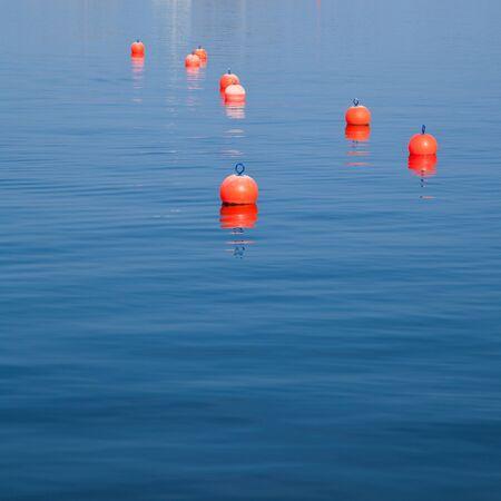 buoys: orange buoys