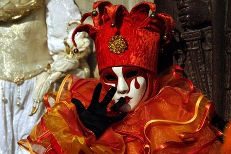 impassive: orange jester costume