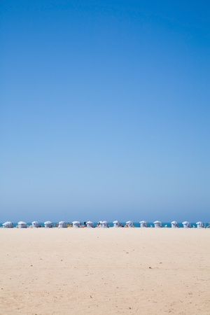 sunshades: beach background with a row of sunshades Stock Photo