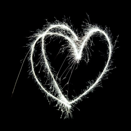 symbolic heart shape drawn in the air with a sparkler trail photo