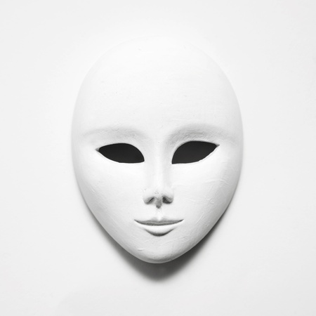 white mask on white paper; square format photo