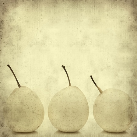 textured old paper background with  Chinese White Pears (Duck Pear; Ya Pear) photo