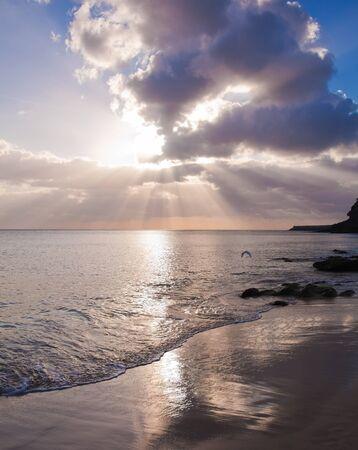 sunset over ocean photo