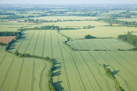 view over the early summer green fields from hot air balloon; East Anglia; UK; photo