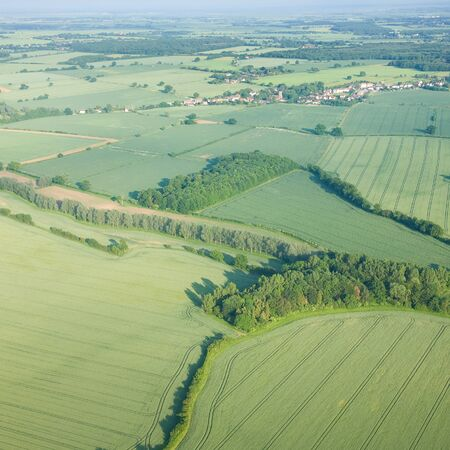 view over the early summer green fields from the air; East Anglia; UK photo