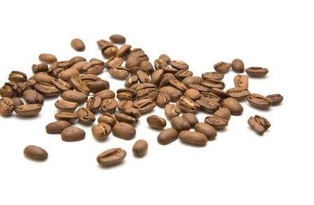 handful of coffee beans isolated on white background photo