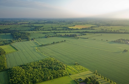 aerial views: view over the early summer green fields from the air; East Anglia; UK