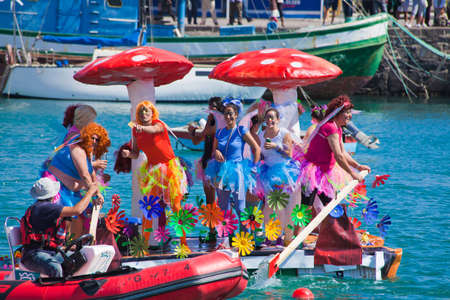 Participants take to water in a variety of unlikely crafts in the port for the yearly  Regata de Achipencos  in Puerto del Rosario, Fuerteventura, Canary Islands   Regata  is a part of yearly carnival events  ACHIPENCO is an acronym of Artilugio Carnavale Stock Photo - 12790084