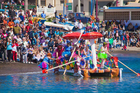 Participants take to water in a variety of unlikely crafts in the port for the yearly  Regata de Achipencos  in Puerto del Rosario, Fuerteventura, Canary Islands   Regata  is a part of yearly carnival events  ACHIPENCO is an acronym of Artilugio Carnavale Stock Photo - 12790086
