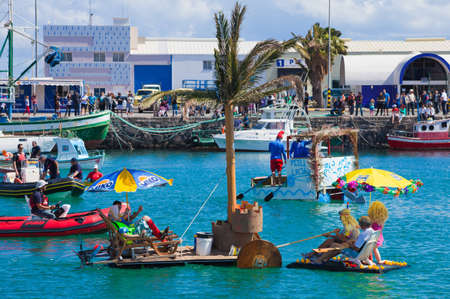 Participants take to water in a variety of unlikely crafts in the port for the yearly  Regata de Achipencos  in Puerto del Rosario, Fuerteventura, Canary Islands   Regata  is a part of yearly carnival events  ACHIPENCO is an acronym of Artilugio Carnavale Stock Photo - 12790088