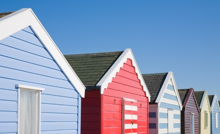 row of colorful beach huts under blue sky Stock Photo - 12794920