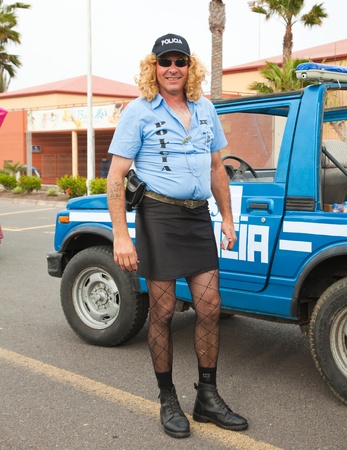 CORRALEJO - MARCH 17: Cross-dressed participant,