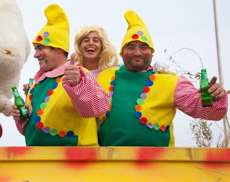 CORRALEJO - MARCH 17: Dressed-up participants on a carnival Float at Grand Carnival Parade, March 17, 2012 in Corralejo, Fuerteventura, Spain  Stock Photo - 12926264