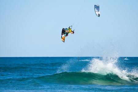 CORRALEJO, SPAIN - APRIL 28  Kitesurfer enjoys perfect wind and waves combination  on 28 April 2012 in Corralejo, Fuerteventura, Spain