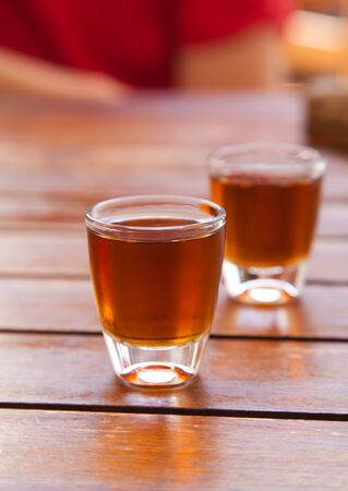 two small glasses of cold honey rum (ron miel), often served after meals in Canarian restaurants) Stock Photo - 13454750