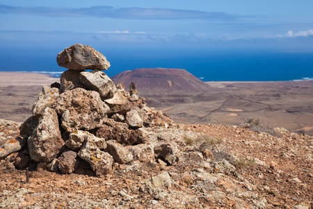 Northern Fuerteventura, Canary Islands, stone cairns on the top of Bayuyo volcano next to Corralejo photo