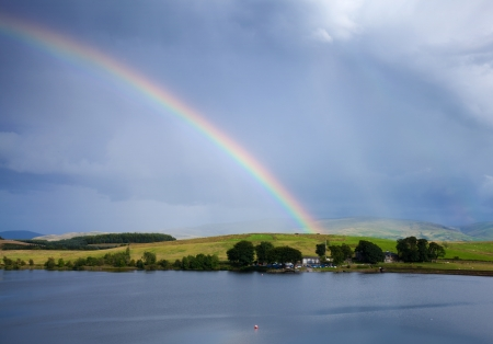 boathouse: rainbow over a lake, boathouse Stock Photo